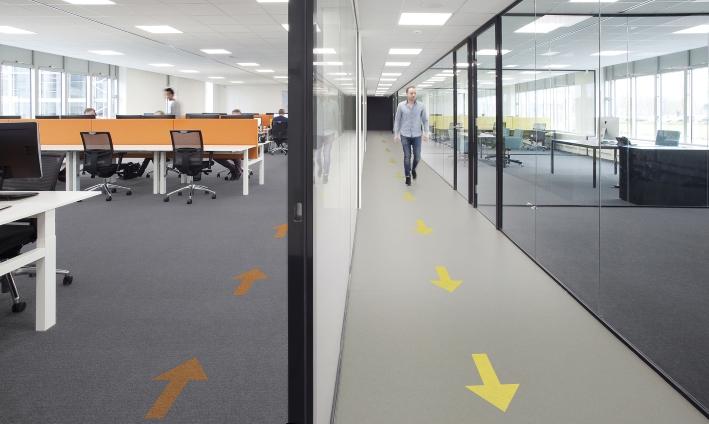 arrows on floor one way system social distancing